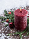 Rustical candles in the snow red Stock Images