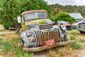 Rusting car in junk yard old chevrolet a desert Stock Photography