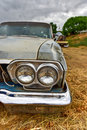 Rusting car in junk yard old a desert Royalty Free Stock Photos