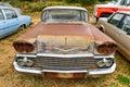 Rusting car in junk yard old a desert Stock Photos