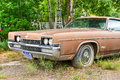 Rusting car in junk yard old a desert Royalty Free Stock Photo