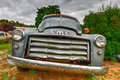 Rusting car in junk yard old gmc a desert Royalty Free Stock Photo