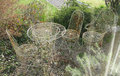 Rusting garden furniture wire chairs and table Royalty Free Stock Photos