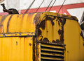 Rusting yellow crane in an old train yard Royalty Free Stock Photos