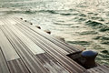 Rusty anchorage boat dock defocused green sea background inclement weather Stock Images