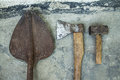 Rusty ax hammer and shovel on a white background