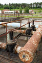 Rusty big taps and pipes water treatment plant valves gate in dirty liquid bubble in background Stock Photography