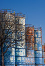 Rusty Blue Tanks on a Blue Sky Stock Image