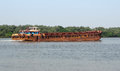 Rusty boat at mandovi river in goa india Stock Image