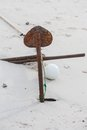 Rusty boats anchor solid in the sand Royalty Free Stock Photo