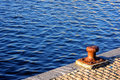 Rusty bollard on port water Royalty Free Stock Images