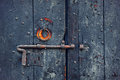 Rusty bolt on old wooden door closeup image of with metal knob and Stock Images