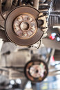 Rusty brake disc waiting for maintenance in service garage closeup Stock Image