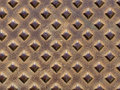 Rusty bumps metal plate with diamond shaped Stock Photography