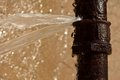 Rusty burst pipe Royalty Free Stock Photo