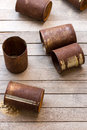 The rusty cans on slat Royalty Free Stock Image