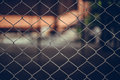 Rusty Chain Link Fence of steel netting on blur background. Royalty Free Stock Photo