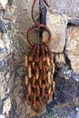 Rusty chain a old on the wall of a castle in madeira Royalty Free Stock Images