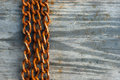 Rusty chains background on wood texture Royalty Free Stock Images