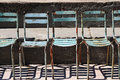 Rusty chairs a row of Royalty Free Stock Image