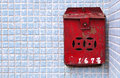 Rusty Chinese postbox on a blue tiled wall, Hong K Royalty Free Stock Photo