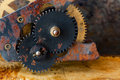 Rusty cogs gear mechanical transmission. industrial machinery vintage design wheels on grungy corroded metallic