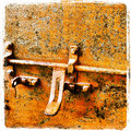 Rusty colored lock close up of a photographed with an iphone s and edited with instagram app Royalty Free Stock Images