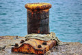 Rusty dock bollard in port Stock Images