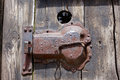 Rusty door closer Royalty Free Stock Photo