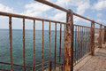 Rusty fence near the sea old and Royalty Free Stock Photography