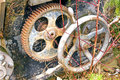 Rusty gear wheel of a press Stock Images
