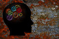 Rusty gears on human head grunge texture background colorful metal silhouette Stock Photography