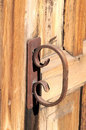 Rusty handle old on a wooden church door Stock Photos