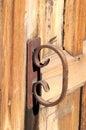 Rusty handle old on a wooden church door Stock Photos