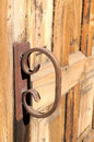 Rusty handle old on a wooden church door Stock Photography