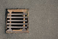Rusty hatch drain on the road Royalty Free Stock Photos