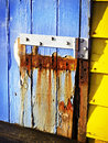 Rusty hinge an old broken wooden door Royalty Free Stock Photo