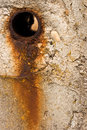 Rusty hole in concrete wall Stock Photography