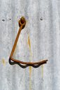 Rusty hook large attached to corrugated iron building Stock Photography
