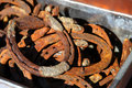 Rusty horse shoes many in the metal box Royalty Free Stock Photos