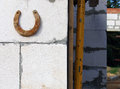 Rusty horseshoe on the wall from white block Stock Photo