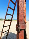 Rusty iron and stairs on the sand