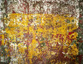 Rusty iron wall covered with paint, abstract texture background. Royalty Free Stock Photo