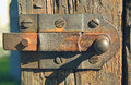 Rusty latch old on a wooden wicket Royalty Free Stock Photo