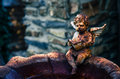 Rusty little angel sitting in the stoup Stock Photos