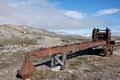 Rusty machine in new london is an abandoned marble mining settlement on spitsbergen svalbard Royalty Free Stock Photos