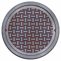 Rusty manhole cover Stock Images