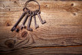Rusty medieval keys on wood table Royalty Free Stock Photo