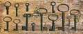 Rusty medieval keys on worn out wood table Royalty Free Stock Photo