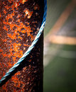 Rusty metal bar with blue rope Royalty Free Stock Image